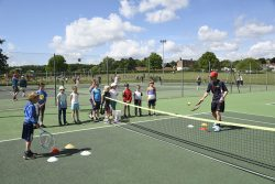A junior coaching session at Woodbridge Tennis Club