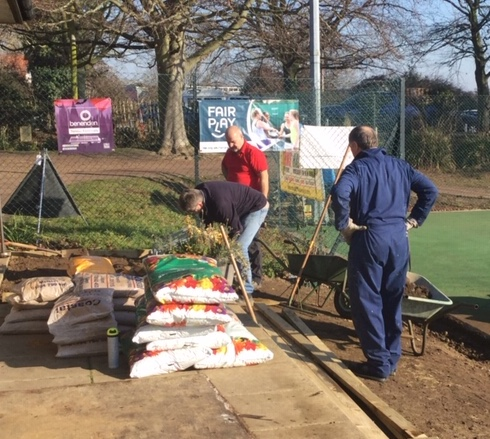 Hard at work on the new garden at Woodbridge Tennis Club