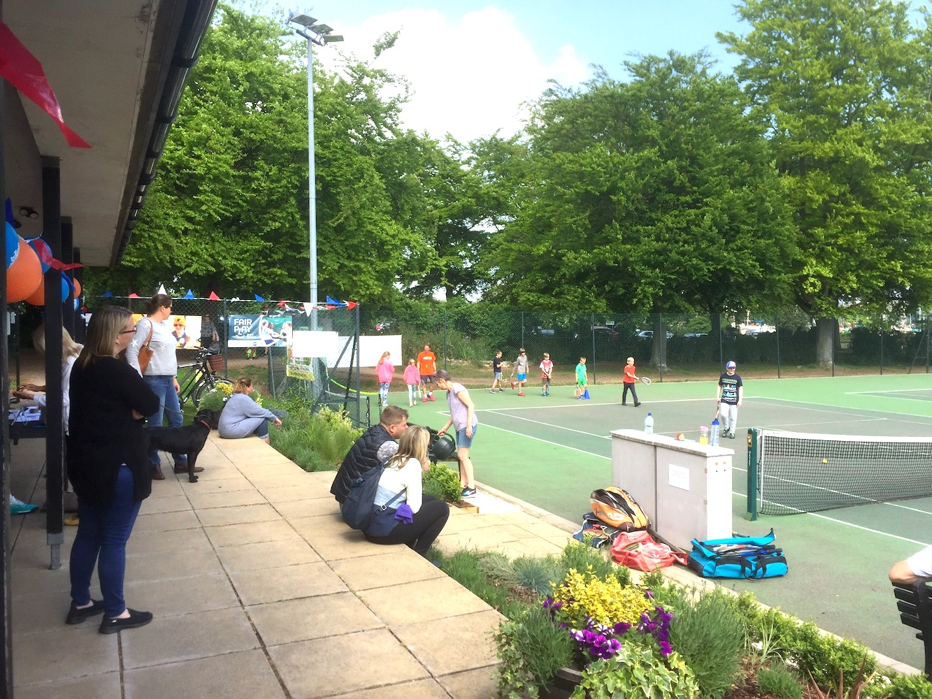 Visitors watching tennis at the Big Tennis Weekend at Woodbridge Tennis Club